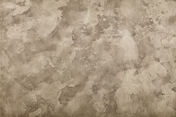 Grunge pastel grey and brown faded uneven old aged daub plaster wall texture background with stains and paint strokes, close up