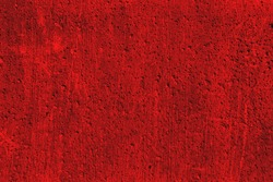 Grunge plaster cement or concrete wall texture red color with scratches