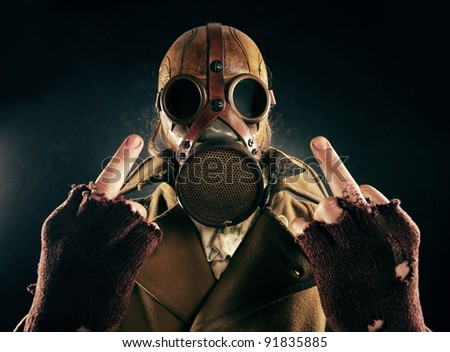 grunge portrait man in gas mask, fuck sign