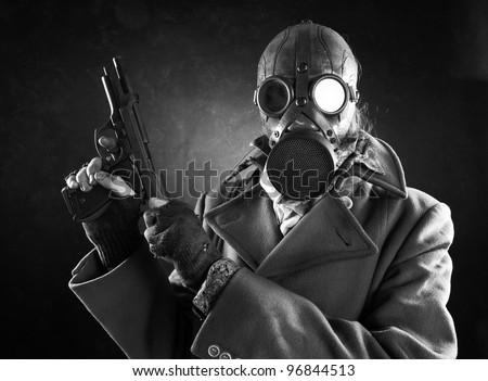 grunge portrait man in gas mask  with gun