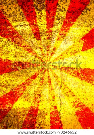 Grunge red and yellow cracked starburst background