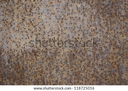 Grunge rust metal plate with a lot of holes