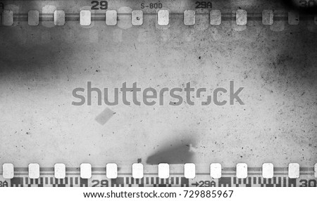 Grunge scratched dirty film strip background with blurred effect. #729885967