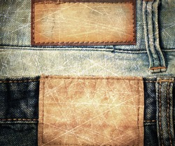 grunge scratched leather jeans label sewed on jeans.