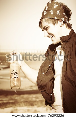 Grunge Sepia Image Of A Pirate Laughing And Playing While Shaking Spraying And Spilling Dangerous Liquid Droplets Of Toxic Chemicals Outdoors