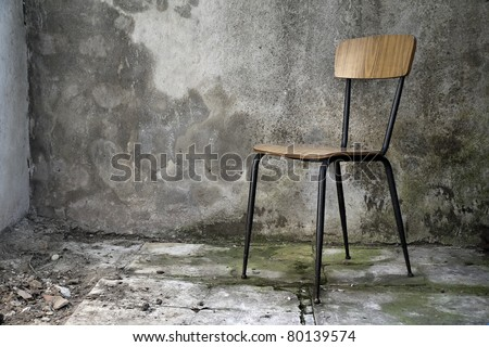 grunge shabby interior with a simple single chair