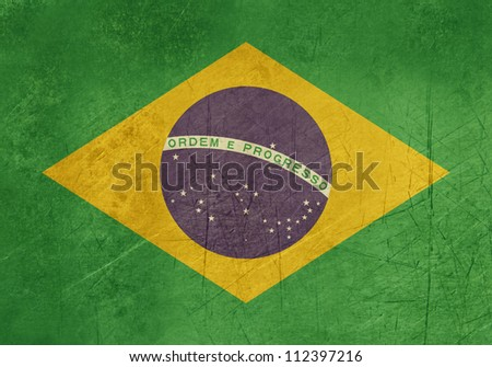 Grunge sovereign state flag of country of Brazil in official colors.