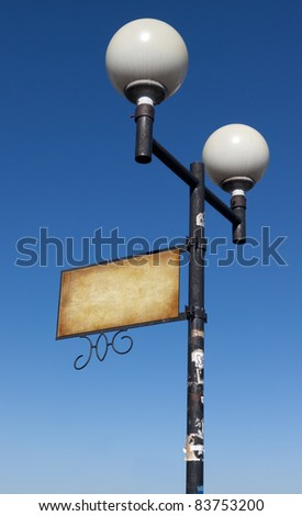 Grunge street lamp with a sign for advertising