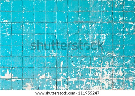 Grunge texture of blue broken tiles on old wall
