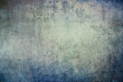 Grunge, textured concrete wall with subtle blue, grey, green and brown hues.