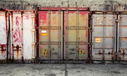 Grunge urban interior with old metal cargo containers
