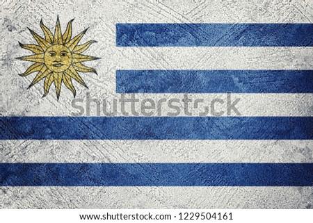 Grunge Uruguay flag. Uruguay flag with grunge texture. #1229504161