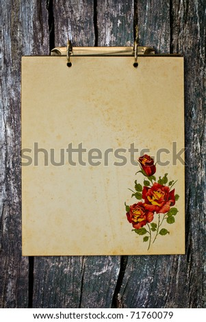 Grunge vintage old blank paper on wood wall with rose