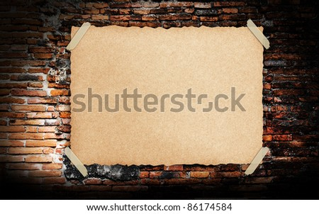 Grunge vintage old Brown paper on brickwall background