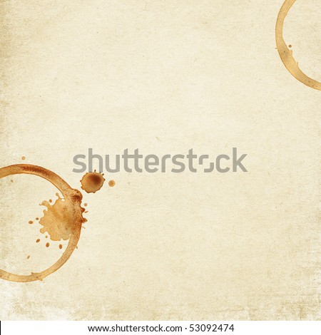 Grunge vintage paper background with coffee rings.