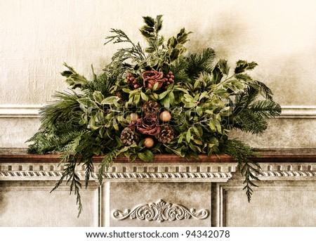Grunge vintage Victorian Christmas floral arrangement decoration with roses and pine branches with green foliage on antique fireplace mantel in old historic home aged postcard style nostalgic colors