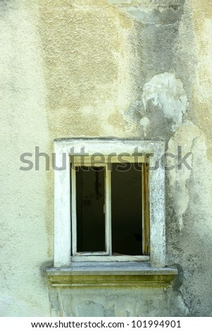 Grunge wall of the old house with open winodow. Textured background