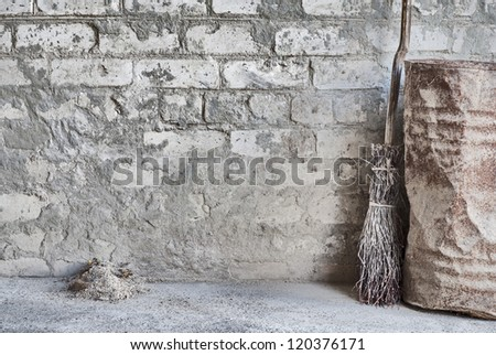 grunge wall, wooden broom and old barrel background