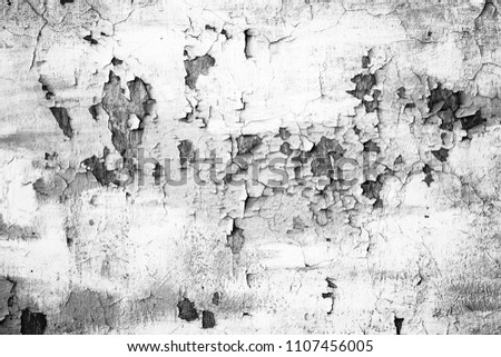 Grunge white metal wall with peeling paint, close-up background photo texture