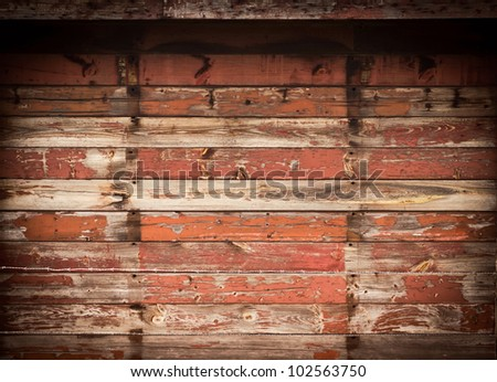 Grunge wood background with barb wire and  black vignette