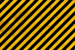 Grunge yellow and black diagonal stripes. Industrial warning background, warn caution, construction, safety