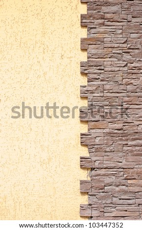 Grunge yellow concrete wall in a brick frame conceptual background texture