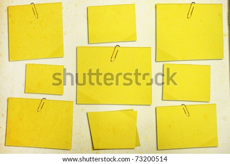grunge yellow memo stick on background