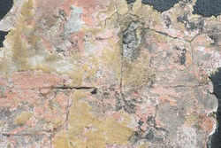 Grungy abstract textured weathered stone concrete wall with earthy natural colour tones