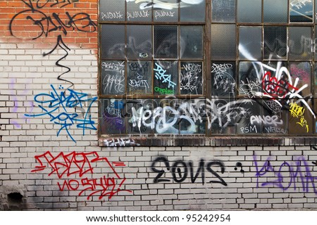 Grungy alleyway in Denver Colorado with graffiti.