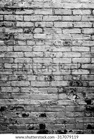 Grungy brick wall, black and white, Vertical, with vignette. Room for text