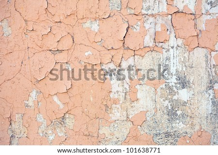 Grungy brick wall   with cracked and pealing paint