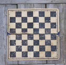 Grungy chessboard stained background