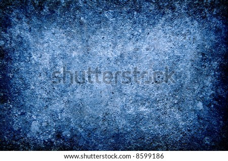 Grungy colored in blue concrete wall closeup background texture