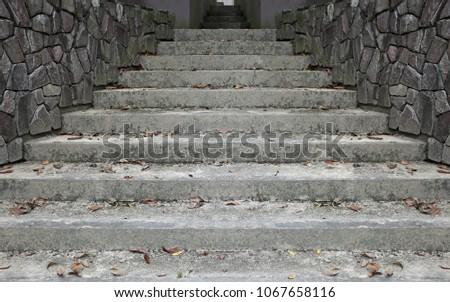 Grungy concrete staircase up a corridor.  #1067658116