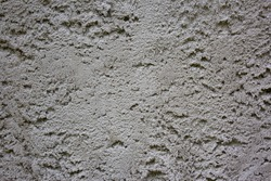 Grungy dark concrete wall for background. Cement texture use for background. Background of cement plaster. Covering the basement of the walls of houses with cement mortar. Construction technologies.