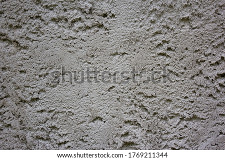 Grungy dark concrete wall for background. Cement texture use for background. Background of cement plaster. Covering the basement of the walls of houses with cement mortar. Construction technologies. ストックフォト ©