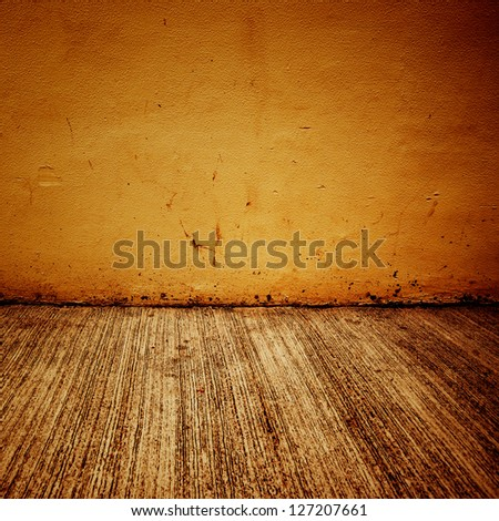 Grungy distressed stone wall and floor with large cracks