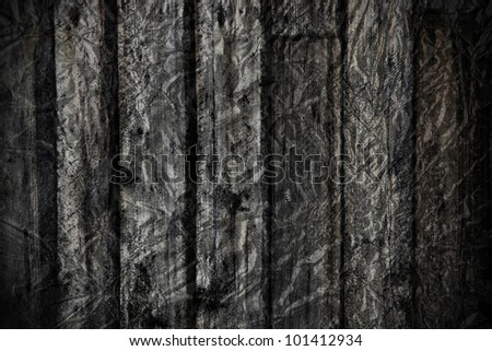 Grungy dramatic black and white old exterior rough wood plank with foil textured applied to create great scary dark background and texture.