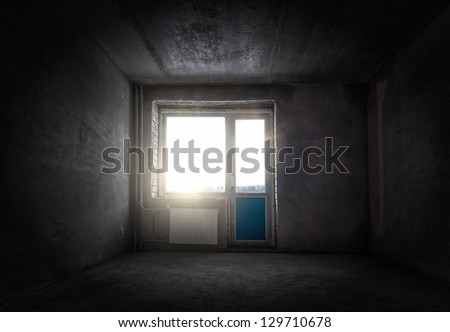Grungy empty room with gray walls and a window #129710678