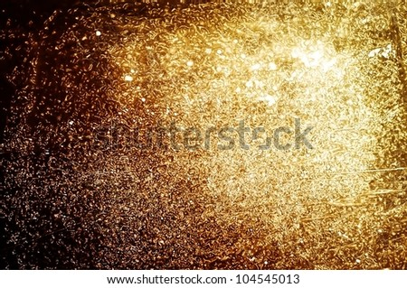Grungy golden and shiny background