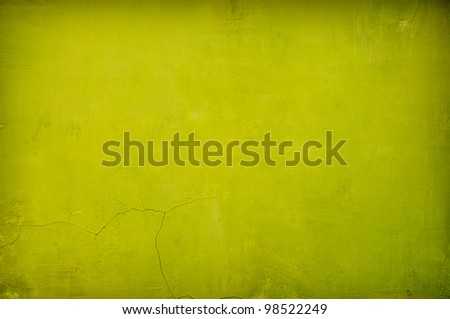 grungy green vintage concrete background with shadows added