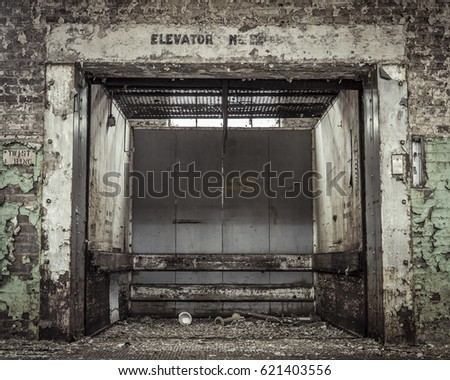 grungy industrial elevator in...