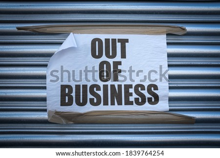 Grungy Out Of Business Sign On Some Old Store Shutters, A Consequence Of The 2020 COVID Pandemic Stock photo ©