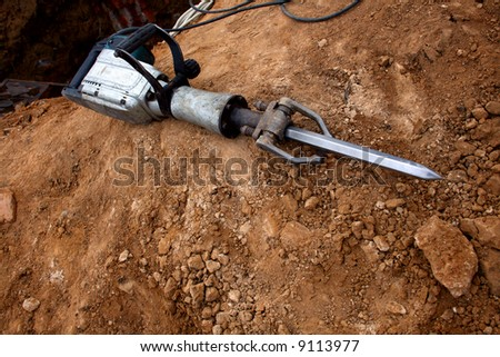 Grungy Pneumatic Hammer lying on ground