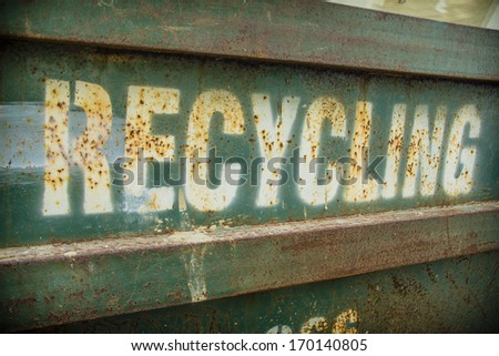 Grungy recycling sign