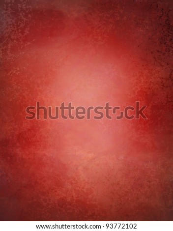 grungy red background paper with slight marbled texture and faded old highlight in center of frame for copy space - stock photo