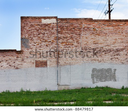 Grungy red brick wall of an old abandoned warehouse in downtown Denver Colorado.