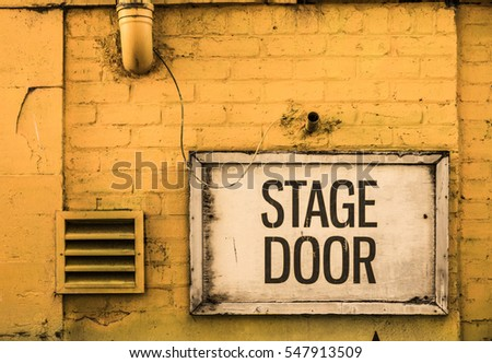 Grungy Stage Door Sign Outside A Theatre