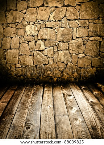 Grungy stone wall and wooden floor