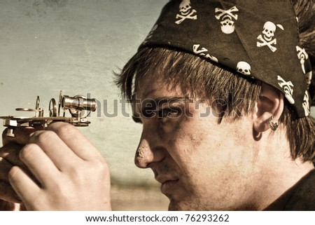 Grungy Textured Image Of A Male Pirate Profile Looking Through The Eye Piece On A Vintage Nautical Compass In A Maritime Conceptual